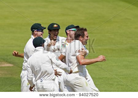LONDON, ENGLAND - July 18 2013: Ryan Harris celebrates taking the wicket of Kevin Pietersen on day one of the Investec Ashes 2nd test match, at Lords Cricket Ground on July 18, 2013