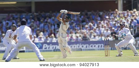 iLONDON, ENGLAND - July 19 2013: Phillip Hughes hits the ball in the air and is caught out by Kevin Pietersen during day two of the Investec Ashes 2nd test match, at Lords Cricket Ground