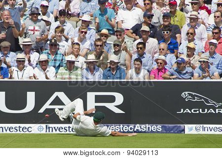 LONDON, ENGLAND - July 18 2013: Shane Watson fails to prevent a boundary on day one of the Investec Ashes 2nd test match, at Lords Cricket Ground on July 18, 2013 in London, England.