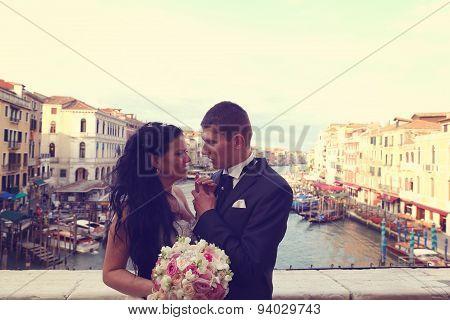 Bride And Groom On A Bridge In Venice
