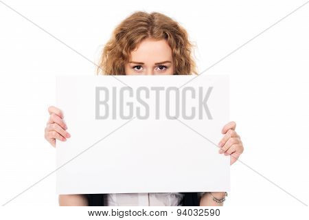 Young Woman Eyes Over A Blank Promotional Display Isolated On A White Background
