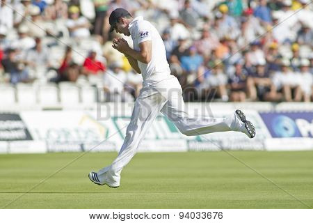 LONDON, ENGLAND - July 19 2013: Kevin Pietersen catches the ball to dismiss Ryan Harris and end the Australian innings during day two of the Investec Ashes 2nd test match, at Lords Cricket Ground