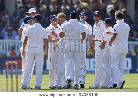 LONDON, ENGLAND - July 21 2013: Joe Root gets congratulated by his team mates after taking the wicket of Usman Khawaja during day four of the Investec Ashes 2nd test match, at Lords Cricket Ground