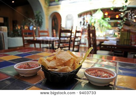 Tortilla chips and salsa in a restaurant poster