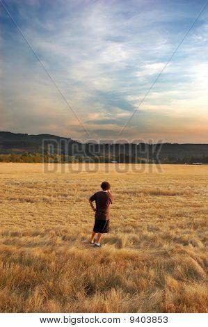 Man Looking At A Beautiful Field