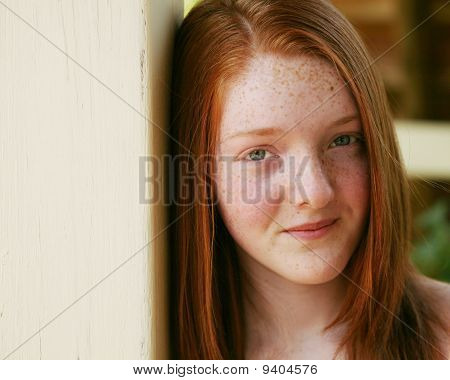 Closeup Of Redhead Girl With Freckles