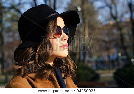 Portrait Of The Beautful Fashionable Girl Outdoor On Sunny Spring Day