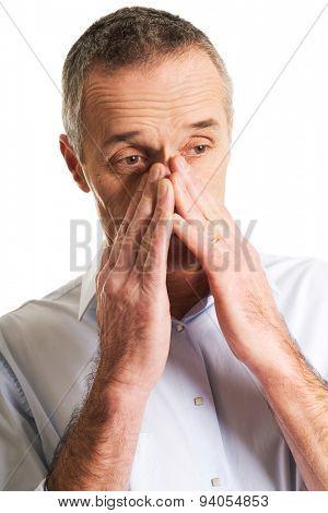 Mature man suffering from sinus pressure pain. poster