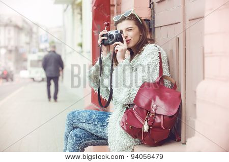 fashion women tourist keep digital compact camera and look photo on screen. Hipster style sunglasses