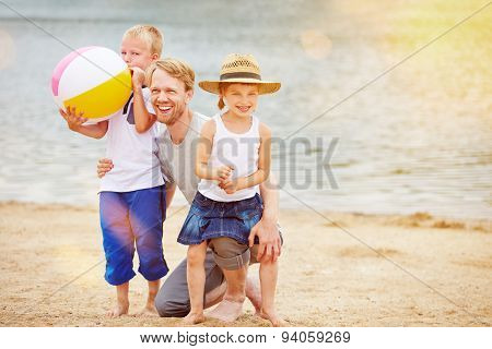 Family with two children on beach on vacation in summer
