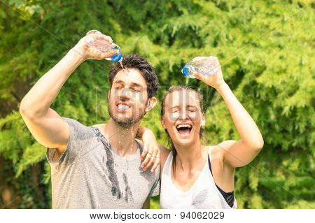 Sport Happy Couple Refreshing With Cold Water After Run Training In The Park - Life Fitness Concept