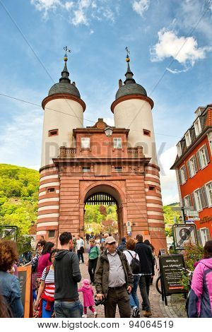 HEIDELBERG, GERMANY - APRIL 26: Throngs of Tourists Gathered Around Old Bridge Gate, a Popular Tourist Destination in Heidelberg, Baden-Wurttemberg, Germany on April 26, 2015