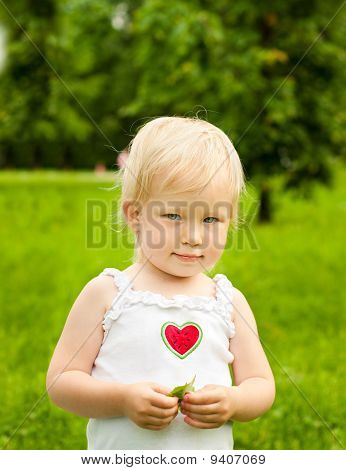 young blond girl in the city park
