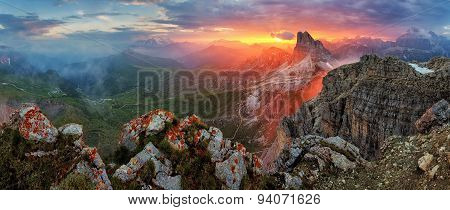 Panorama Dramatic Sunset In Dolomites Alp Mountain From Peak Nuvolau