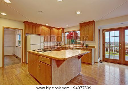 Classic Hardwood Kitchen With Connected Living Room.
