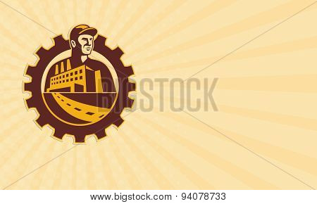 Business card showing illustration of a factory worker mechanic tradesman with factory building set inside cog mechanical gear done in retro style. poster