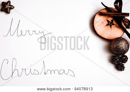 Merry Christmas greeting with apple decoration on white