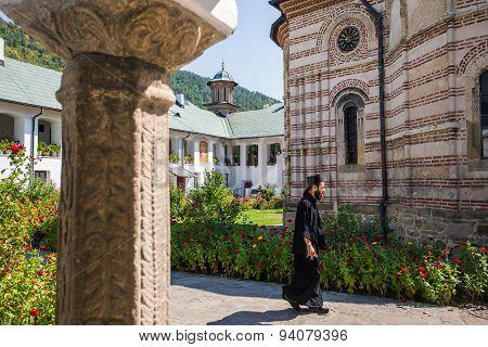 Priest Walking Inside Cozia Monastery