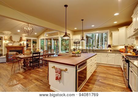 Classic Kitchen With Hardwood Floor And An Island.