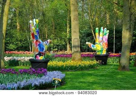 Colorful Hands In Keukenhof Park in Lisse, Holland on April 2011