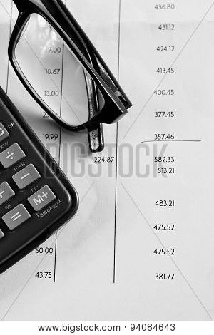Bank statement with glasses and calculator number in column underlined poster