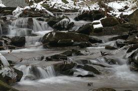 Flowing Creek In Winter