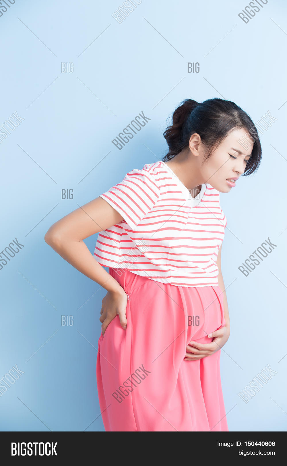 7461c2b9ff2b3 pregnant woman have pain isolated on bluebackground asian
