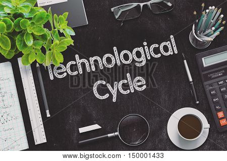 Technological Cycle Handwritten on Black Chalkboard. Top View of Black Office Desk with a Lot of Business and Office Supplies on It. 3d Rendering. Toned Illustration.