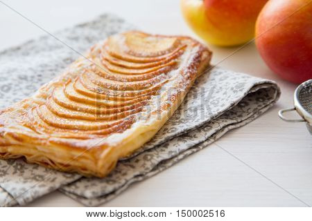 Homemade Organic Ruddy Pies With Apples Puff Pastry, Ready To Eat. Delicious Apple Puff On A Light W
