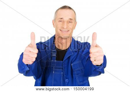Repairman showing thumbs up