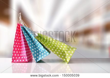 Three Bags Colored With White Circles In A Mall Front