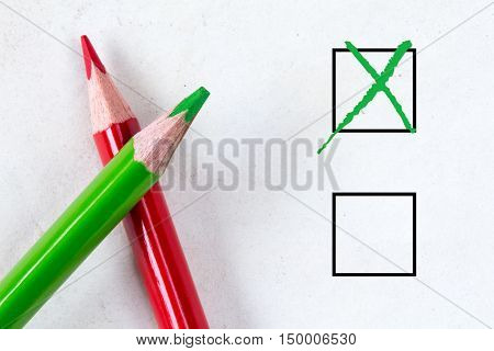 Green and red pencils with marking checkbox. Concept for customer satisfaction surveyeducation research or election