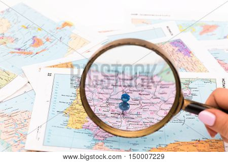 The magnifying glass on a map - close-up