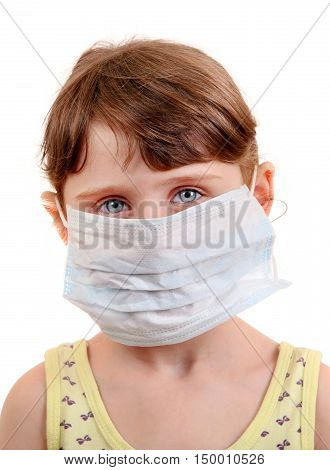 Sad and Sick Small Girl in Flu Mask on the White Background