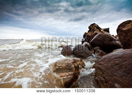 Cape Kolka on the Baltic Sea, near the entry to Gulf of Riga. Dramatic sky and storm in the sea