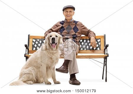 Smiling senior man sitting on a bench with his dog and looking at the camera isolated on white background