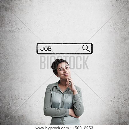 African American woman standing near concrete wall with search bar sketch and word job. Concept of job finding. Mock up
