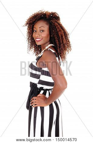 A gorgeous young African American woman standing in a black and white jumpsuit isolated for white background.