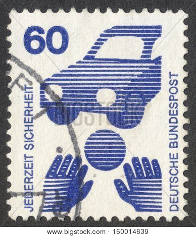 MOSCOW RUSSIA - CIRCA SEPTEMBER 2016: a stamp printed in GERMANY shows a ball in front of a car (Child Road Safety) the series