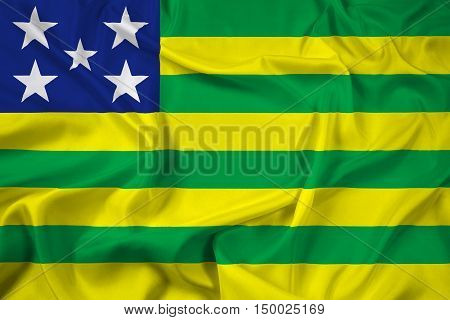 Waving Flag of Goias State Brazil, with beautiful satin background. 3D illustration