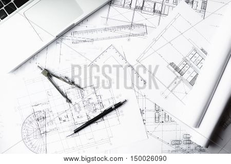 Image of engineering objects on workplace top view.Construction concept. Engineering tools.Vintage tone retro filter effectsoft focus(selective focus)