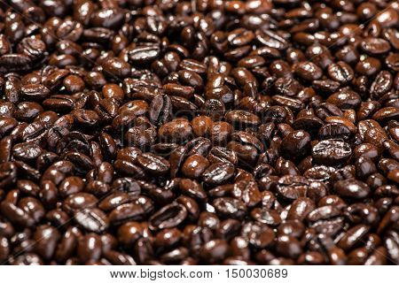 Roasted coffee beans background. Coffee beans. Coffee