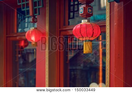 Two Red Chinese Traditional Paper Lanterns Outside The Restaurant. Elements Of Exterior Decor Of National Oriental Style.