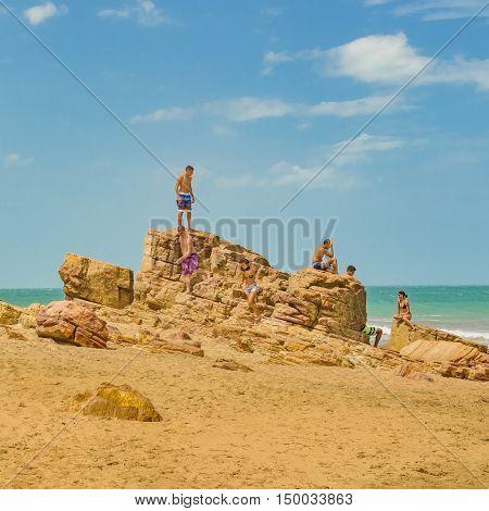 JERICOACOARA, BRAZIL, DECEMBER - 2015 - Group of people at rocks at beach in Praia Malhada Jericoacoara Brazil