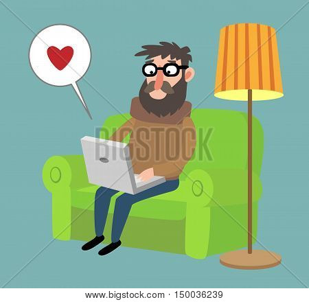 a man sitting on the couch with a laptop on his lap