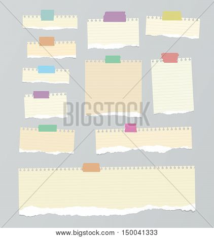 Pieces of light brown ruled torn note paper with yellow adhesive, sticky tape are stuck on background.