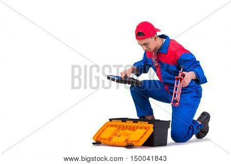 Young repairman with silicone gun isolated on white