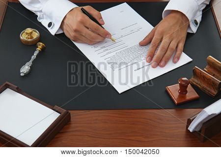 Notary public signing document in office