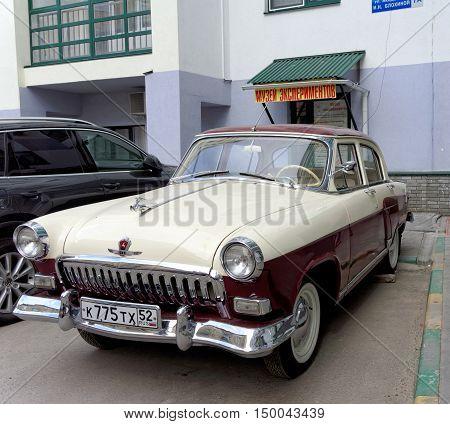 Nizhny Novgorod Russia. - May 20.2016. Restored vintage car Volga GAZ-21 in the yard of a house