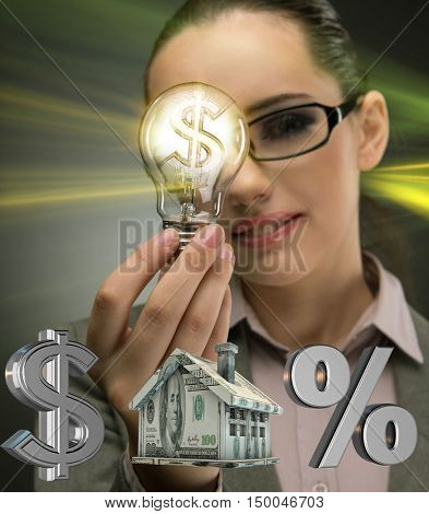 Young woman with lightbulb in mortgage concept